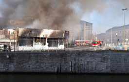 Fire destroys canalside furniture store, one injured