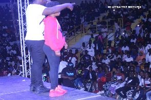 Nii Funny performs with pregnant woman at Fancy Gadam's concert